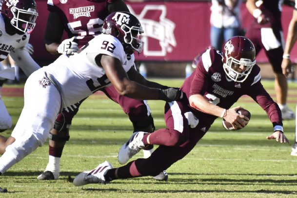 Texas A&M defensive lineman Jayden Peevy (92) sacks Mississippi State quarterback K.J. Costello (3) during the second quarter Saturday at Davis Wade Stadium in Starkville.