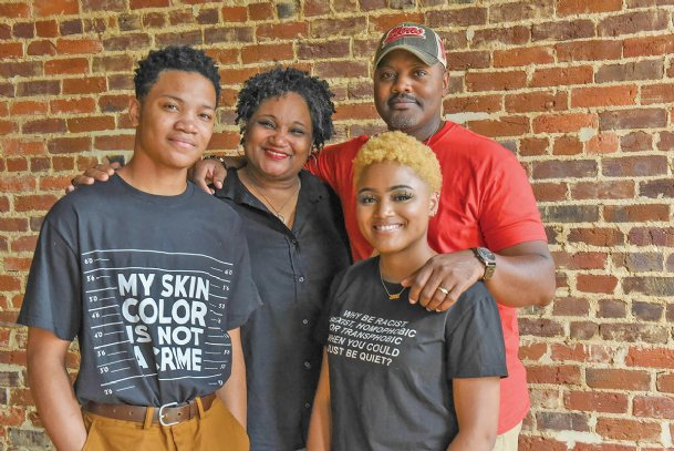 From left, Kyle Alexander, 14, Angela, Morgan Marie, 20, and Terrell Jones pose for a portrait on June 26 in Columbus. Morgan will be a senior at Mississippi University for Women and Kyle will be in ninth grade at Columbus High School. Each member of the Jones family has different preferences for their racial identities. Morgan said she uses African American for formal uses, such as in the newspaper, but uses Black in casual settings. Angela identifies as Black all the time. Terrell said he prefers African American but isn't opposed to being referred to as Black. Kyle identifies as African American all the time.