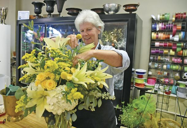 Tammy Youngblood, who owns Ivy Cottage Florist on Highway 45 North in Columbus, prepares a bouquet Friday. Youngblood said she chooses not to judge customers and it will be business as usual once a law that allows businesses to refuse services based on religious grounds goes into effect Tuesday.