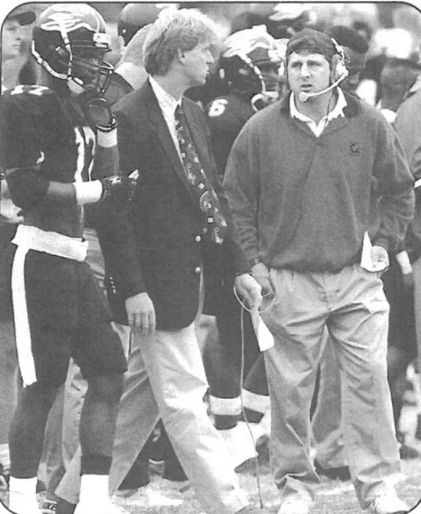 Head coach Hal Mumme (center) and then-offensive coordinator Mike Leach (right) on the sidelines at Valdosta State. The two coaches brought the air raid to the small Georgia school just north of the border with Florida.