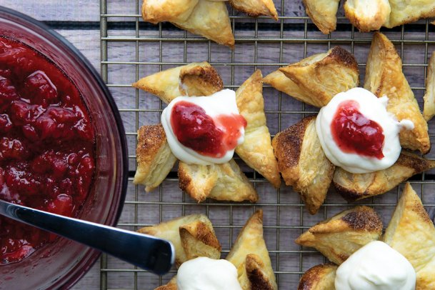 Sweet strawberries, ground cinnamon, sugar and ricotta cheese blend flavors in these puff pastries with strawberry compote.