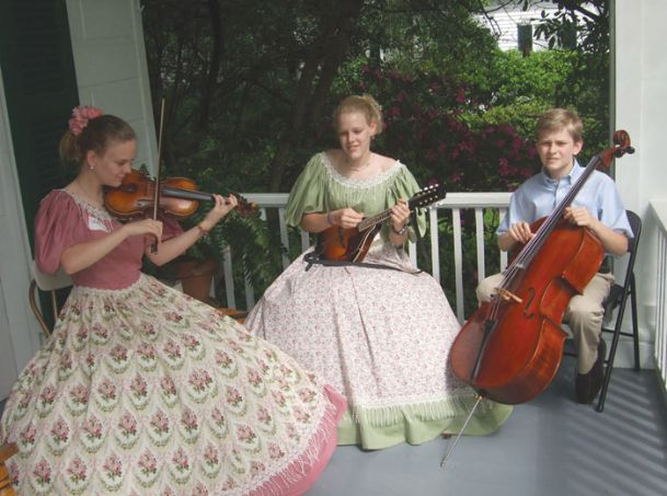 Twins Laura and Lucy Sandifer and their brother, Scott, perform on the porch of Twelve Gables during Pilgrimage.