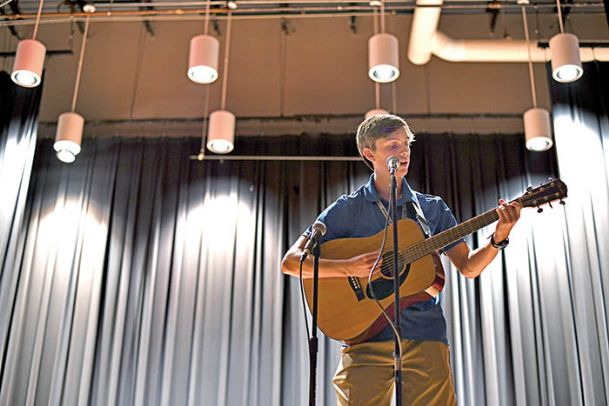"""Cade Meyers, 17, performs during the Mississippi Governor's School talent show on Monday at Mississippi University for Women's Parkinson Hall. Meyers is from Biloxi and began playing the guitar two years ago. """"I love it because it's a great skill to have. It's better than playing video games all the time,"""" Meyers said."""