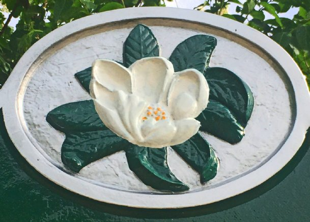The image of a magnolia, similar to that used on our state historic markers, would be fitting for a new state flag, suggests Felder Rushing.