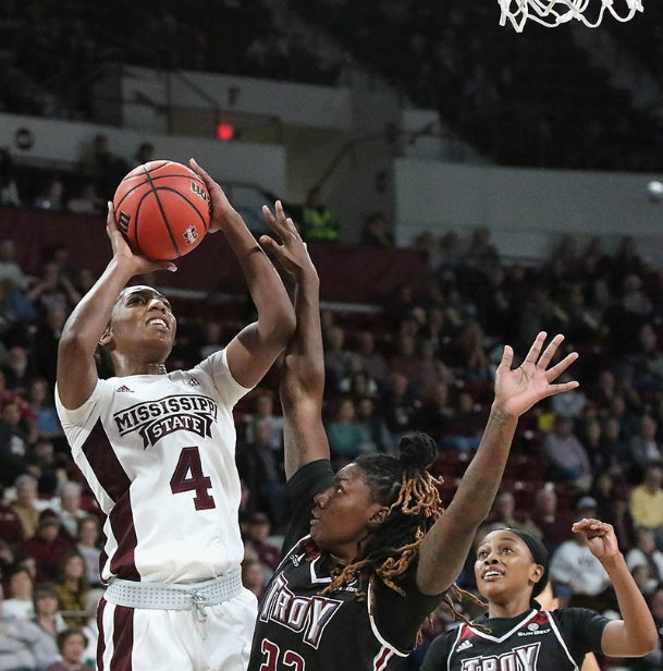 Mississippi State's Jessika Carter (4) shoots over Troy's Kate Rodgers (32) during the second quarter of their NCAA college basketball game Monday night in Starkville.