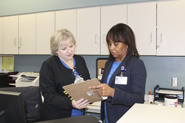 Tumor registrar Maxine Morgan, right, and radiation oncologist Deborah Phelps look over cancer data at Baptist Memorial Hospital-Golden Triangle's Cancer Center on Friday. Morgan has collected data on diagnosis and treatment for every cancer patient who has gone through Baptist since 2006, and sends that data to the Mississippi Cancer Registry for further research into the disease.