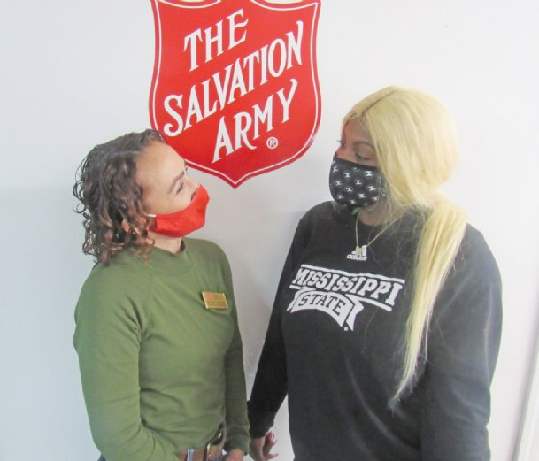 Starkville Salvation Army manager Bethany Westoby, left, says no one is more deserving of a good turn than her assistant Tatiana Burgess, whose enthusiasm and hard work impressed her since she arrived at the organization. A local car club hopes to raise money to purchase a car for Burgess, whose car broke down during the height of the Salvation Army's Christmas drive in December.