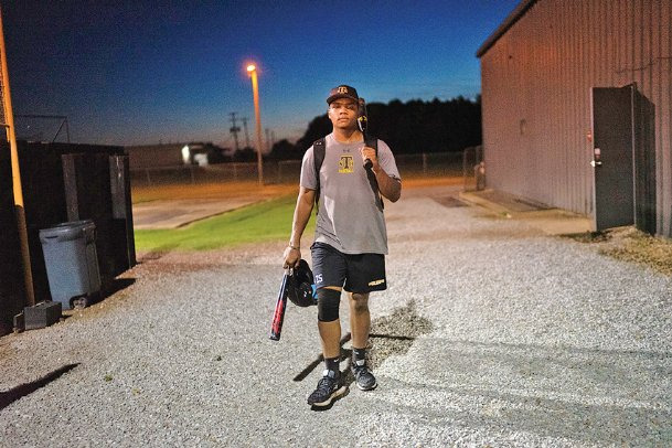 Jeremiah Jethroe walks to his car after his second-to-last baseball practice on July 16 at New Hope High School. Jeremiah, who is going into his senior year, was unable to play last season after breaking his neck more than five months ago in a