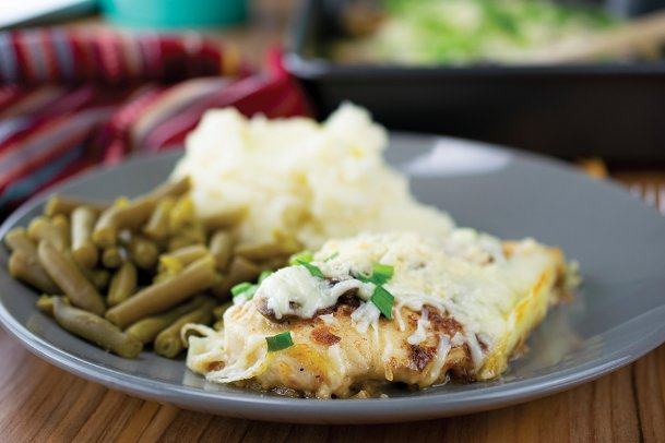 Serve up a comforting family meal with this cheesy baked mushroom chicken.
