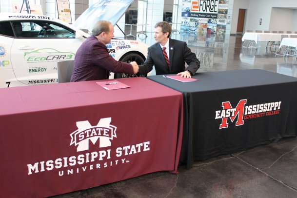 Mississippi State University President Mark E. Keenum, left, and East Mississippi Community College President Scott Alsobrooks shake hands after signing a memorandum of understanding for MSU's Bachelor of Applied Science program Wednesday at the Communiversity on EMCC's Mayhew campus. Students with an associate's of applied science degree will not have to repeat any previous credit hours in order to complete a bachelor's, which will make it easier for them to advance in the workforce, Keenum said.