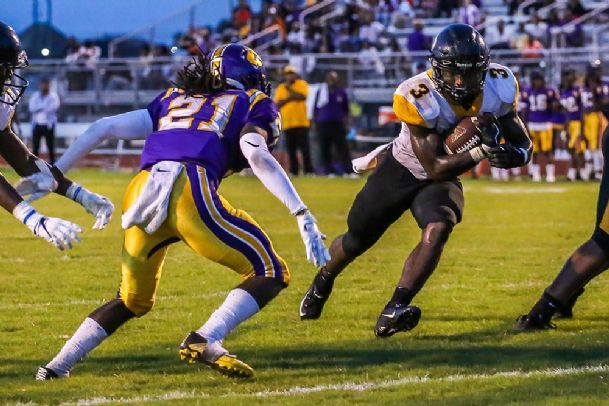 Starkville High School senior running back Rodrigues Clark (3) scored two touchdowns on the day before his 18th birthday.