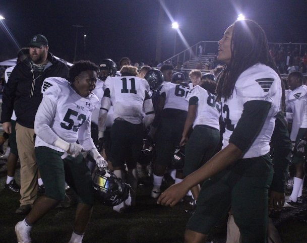 West Point sophomore Jhace Mallard (53) and senior Kylen Armstead (22) celebrate the Green Wave's 29-22 win over Ridgeland in the MHSAA Class 5A north half final on Friday.