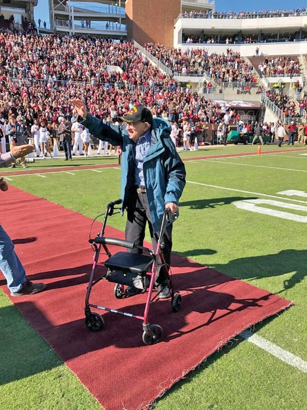 World War II U.S. Army veteran Fred Baker, 98, of Columbus gets a sustained standing ovation from the crowd in Davis Wade Stadium during Mississippi State's home football game Nov. 16 in Starkville. The matchup between the Bulldogs and Crimson Tide of Alabama was designated as MSU's Military Appreciation game.