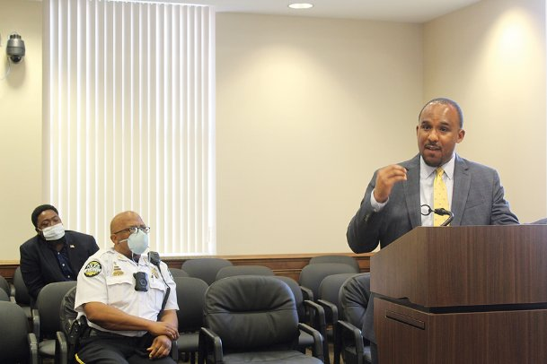 District Attorney Scott Colom speaks during a press conference at Lowndes County Courthouse on May 29. Ward 4 Columbus Councilman Pierre Beard, left, and Columbus Police Chief Fred Shelton listen.