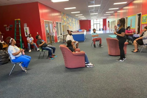 Boys & Girls Club Columbus Unit Director Brittany Turner speaks at a socially-distanced staff meeting at the facility at 1815 14th Ave. N. Even though Golden Triangle clubs will remain closed through the summer, online learning is available.