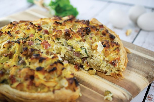 Smoked ham and cheeses add to the flavors in this leek, raisin and ricotta tart.