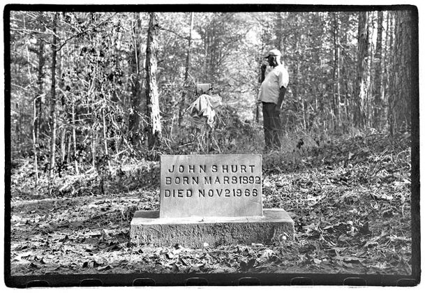 This photograph, taken in the mid-1970s, pictures the grave marker of Delta bluesman Mississippi John Hurt. Hurt, whose music has been covered by musicians as diverse as Bob Dylan to Doc Watson to Jerry Garcia, is buried in Saint James Cemetery near his hometown of Avalon, Mississippi.