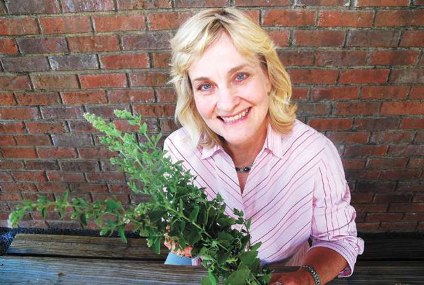 Dr. Lelia Kelly, a consumer specialist with the Mississippi State University Extension Service, is pictured at the Hitching Lot Farmers' Market Saturday in Columbus, where she presented a workshop on herbs.