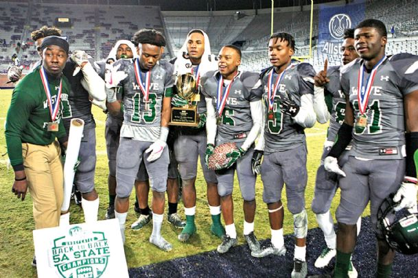 Members of the West Point High School football team pose for a picture following the team's 41-15 victory against Hattiesburg in the Mississippi High School Activities Association (MHSAA) Class 5A State championship game on Dec. 2, 2017, at Vaught-Hemingway Stadium in Oxford.