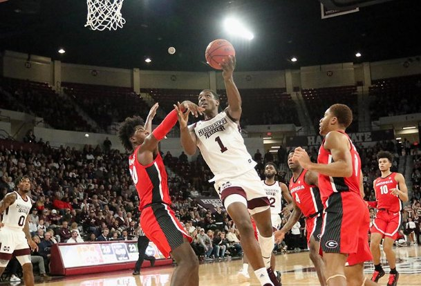 Mississippi State's Reggie Perry (1) drives to the basket and around Georgia's Rayshaun Hammonds (20) during the first half of their NCAA college basketball game Saturday in Starkville.