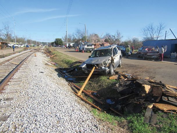 An SUV impaled by a large beam on Railroad Street quickly became a conversation piece Sunday morning. Nearby residents say the driver, a woman, left the SUV uninjured.