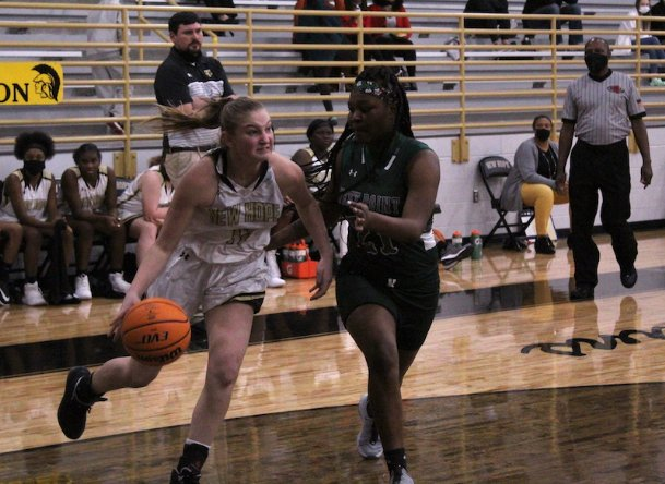 New Hope sophomore Madyson McBrayer (11) drives on West Point's Mikeirria Moore (21) during the third quarter of Friday's game in New Hope. The Trojans beat the Green Wave 46-33.