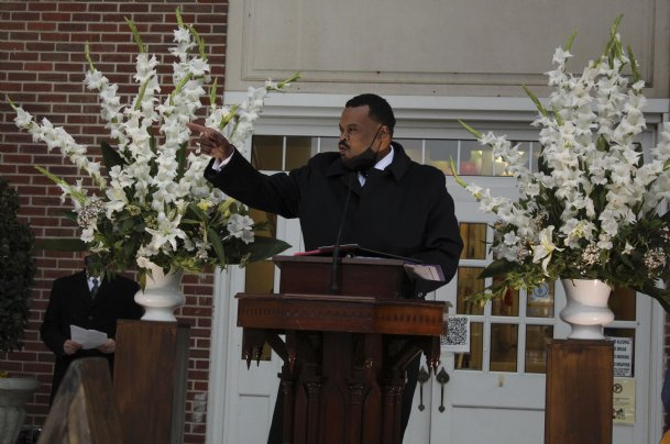 """Mississippi Rep. Kabir Karriem (D-Columbus) points out the house of one of his teachers at Franklin Academy during Friday's bicentennial celebration. """"As we celebrate this 200th anniversary and unveil this monument, we must be vigilant in making sure that quality education remains key, free and accessible to all students,� Karriem said."""