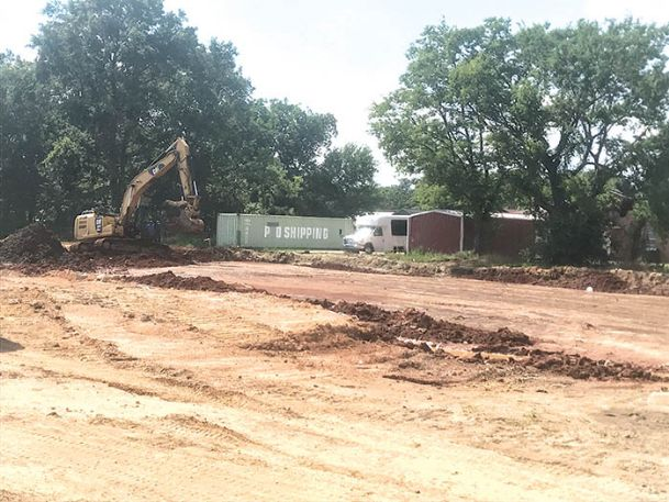 Crews from Lowndes County and the city of Columbus remove dirt from what will soon become the foundation of the new Sim Scott Park Community Center. The city is in the early stages of planning for a new roughly 9,000 square-foot building, which will house classrooms, recreation space and a senior center.