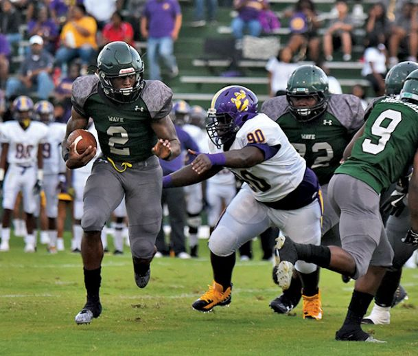West Point High School quarterback Marcus Murphy moves to turn the corner against Columbus last week.
