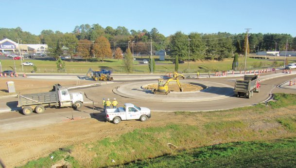 The semi-roundabout construction at the intersection of Military Road and Highway 82 is scheduled to reach completion by the end of November, project manager James Gill told The Dispatch. The construction was originally scheduled to be finished by May but was delayed by bad weather and pass-through traffic.