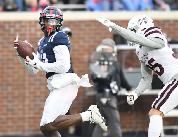 Ole Miss wide receiver Dontario Drummond (11) makes a catch against Mississippi State safety Landon Guidry (35) during Saturday's Egg Bowl at Vaught-Hemingway Stadium in Oxford.
