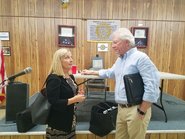 Ellen Weaver Hartman, left, and Jim Hemphill get to know each other after Tuesday's American Legion Post 13 meeting in Starkville. Hartman's and Hemphill's fathers were in the same prisoner of war camp in Poland during World War II.