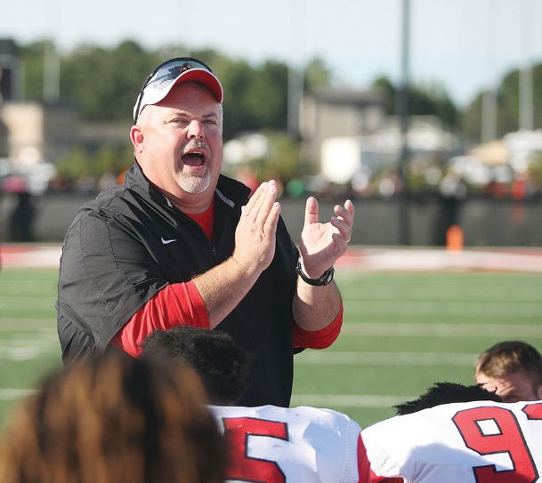 East Mississippi Community College head football coach Buddy Stephens talks with his players in this Dispatch file photo. School officials have confirmed