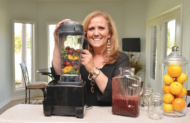 Lacretia Scarboro of Columbus is ready to make a healthy smoothie to go along with her kale chips, energy power balls and gluten-free chocolate chip cookies. The Duke University-trained integrative health coach made changes to her diet and lifestyle in response to a chronic health problem and is now symptom-free.