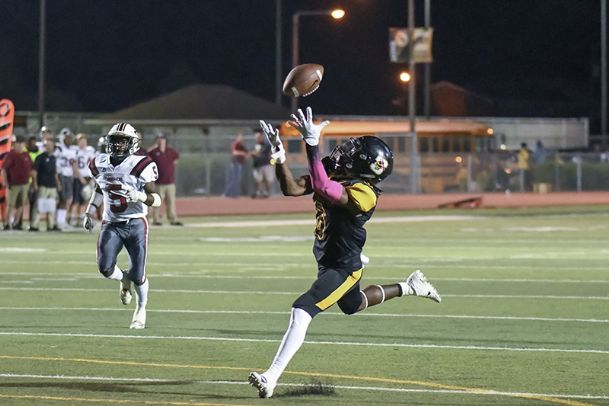 Starkville receiver Rufus Harvey reels in a long catch over the middle in Friday night's game against Germantown.