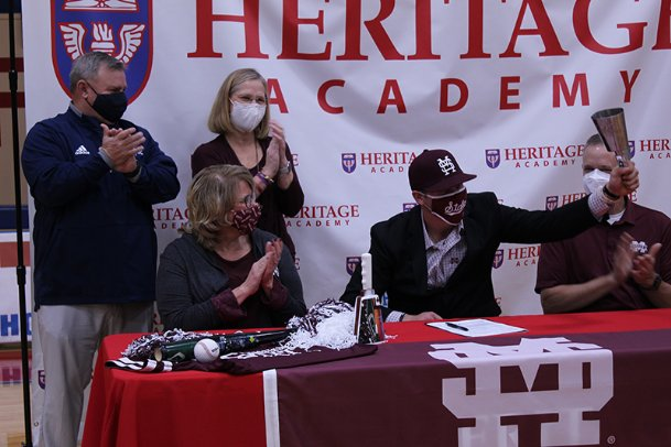 After signing his letter of intent to play baseball at Mississippi State on Monday, Heritage Academy senior Aaron Downs reached for the cowbell sitting on the table. He rang it loudly in a homage to his school of choice.