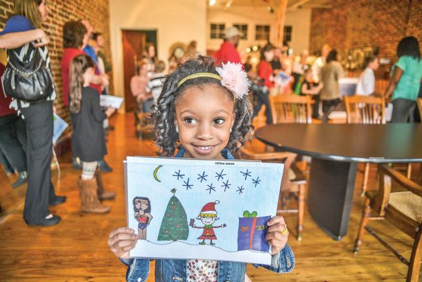 Madison Jackson, 5, shows off her first place award for best drawing in the kindergarten through first grade category Tuesday at The Commercial Dispatch.  Madison is the daughter of Kesha Malone and Carlos Jackson, of Crawford.
