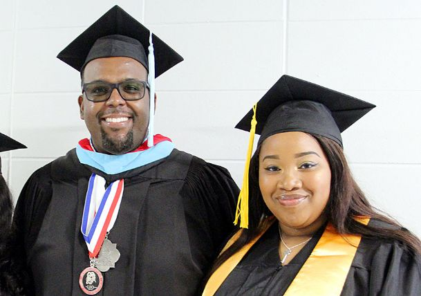 Jaykanze Bryant, right, graduated from East Mississippi Community College May 4 and from Noxubee County High School May 24. She is pictured at EMCC's graduation ceremony on the Scooba campus with EMCC Associate Dean of Instruction James Rush.