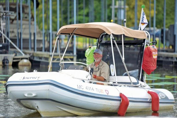 David Pike of Grand Haven, Michigan, stops at the Columbus Marina during his 6,000-mile journey on his dinghy.  Pike will be playing pickleball in Columbus as he has in other towns on this adventure.