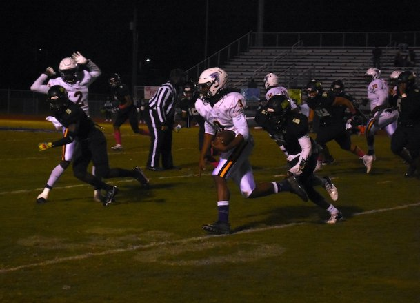 Columbus quarterback Ethan Conner scrambles for a first down Friday night. The Falcons lost 28-0 to Lake Cormorant.