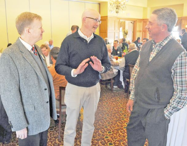 Bronson Strickland, center, associate extension professor at Mississippi State University, speaks with Bill Walker, left, and Walt Starr during the Columbus Rotary Club luncheon at Lion Hills on Tuesday.