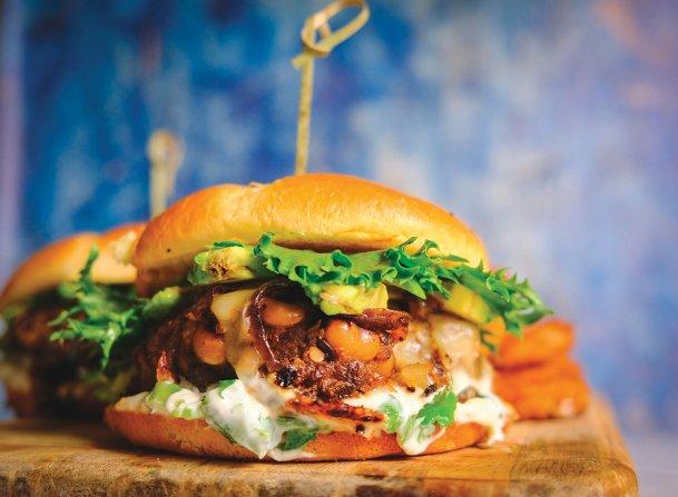 Green Chili Jack Smash Burgers combine ground pork burgers with caramelized onions and charred green chili mayo.