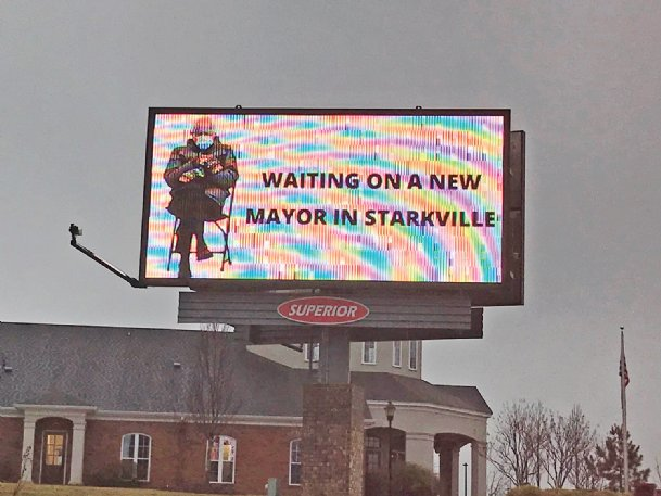 A digital billboard ad on Highway 12 North in Starkville shows a photo from a viral meme of Sen. Bernie Sanders wearing mittens beside the message: Waiting on a new mayor in Starkville. No one other than incumbent Lynn Spruill has qualified yet to run for mayor in this year's municipal elections, and the source for the ad is not identified, which is required for campaign materials under state law.
