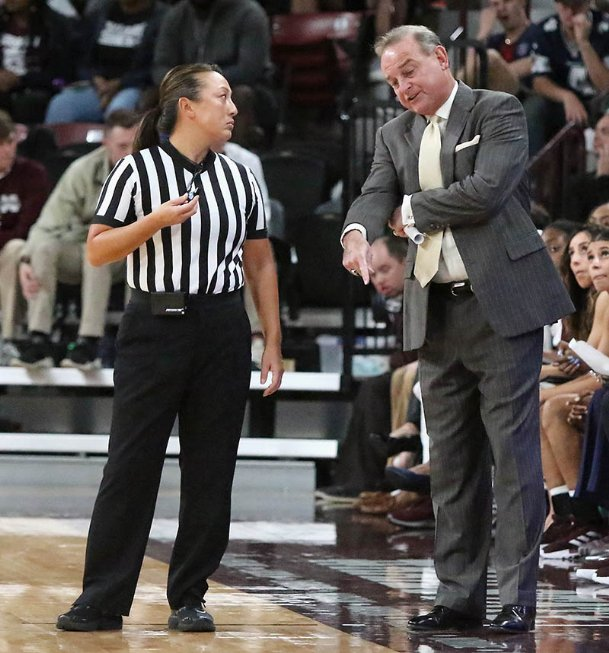 Mississippi State head coach Vic Schaefer discusses a call with game official Cameron Inouye during the second quarter of their NCAA college basketball game against Troy on Nov. 18, 2019 in Starkville.