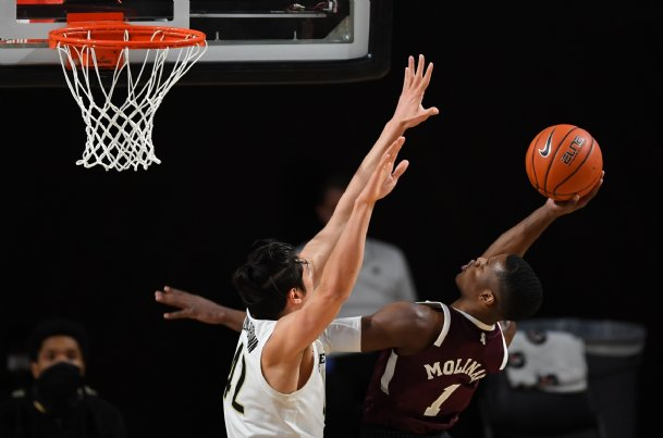 Mississippi State Bulldogs guard Iverson Molinar (1) attempts a shot against Vanderbilt Commodores forward Quentin Millora-Brown (42) during the first half at Memorial Gymnasium.