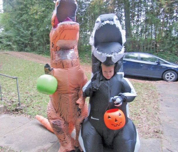 Dinosaurs Mark Leonard, 10, and his brother, David, 8, won't be trick-or-treating this year. Instead, the Columbus brothers will attend a small party after attending a Saturday night wedding.