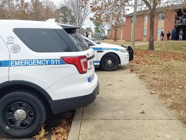 Crowds and emergency vehicles gathered outside the Brookville Garden Apartments buildings Tuesday afternoon while police responded to an apparent homicide. Laterrence McCarter, 23, was found on the east side of the apartment complex.