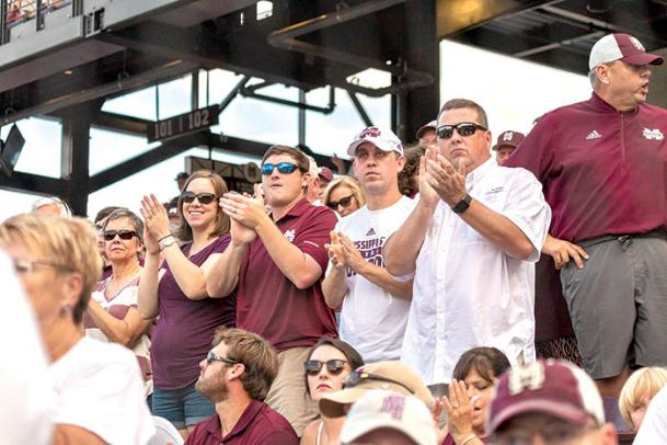 Mississippi State baseball fans cheer during Saturday's NCAA tournament Super Regional contest versus Stanford at Dudy Noble Field. Originally scheduled for 2 p.m., weather threats delayed the first pitch to 7, meaning fans who arrived in the morning to get in line had to wait eight to 12 hours for game time.