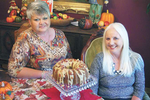 Susan Bell, left, and Jane Kilgore are co-chairing the Caledonia Day Festival apple cooking contest to be judged Saturday. They gathered some friends to demonstrate a few ways apples can be used in a variety of recipes, including Kilgore's apple-cream cheese Bundt cake pictured. The festival is Friday and Saturday.