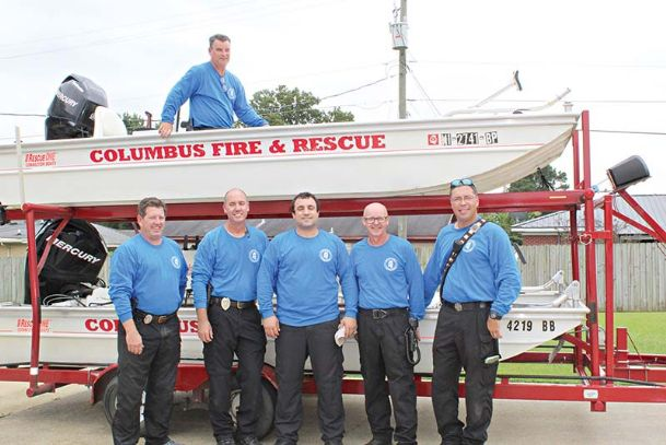 Pictured are members of the Columbus Fire & Rescue Swift Water Rescue team who traveled to areas affected by Hurricane Florence to aid search and rescue efforts. Front row, from left: Battalion Chief Scott Swain, Capt. Chip Kain, Capt. Shannon Murphy, Capt. Melvin Junkin and Engineer Marco Rodriguez. Pictured in one of CFR's rescue boats is Capt. Wes Mims.